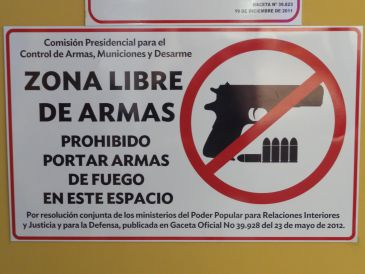 Warning about arms in hotel lobby!